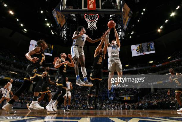 Isaiah Maurice of the Memphis Tigers grabs a rebound against Jaime Echenique of the Wichita State Shockers on January 3 2019 at FedExForum in Memphis...