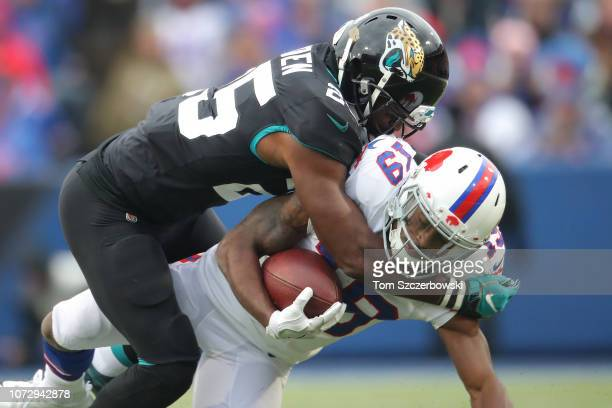 Isaiah McKenzie of the Buffalo Bills is tackled by D.J. Hayden of the Jacksonville Jaguars in the second quarter during NFL game action at New Era...