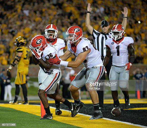 Isaiah McKenzie of the Georgia Bulldogs celebrates his touchdown with Jayson Stanley Jeb Blazevich and Sony Michel during a game against the Missouri...