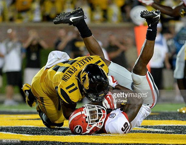 Isaiah McKenzie of the Georgia Bulldogs pulls in a pass for a touchdown against Aarion Maxey-Penton of the Missouri Tigers in the fourth quarter at...