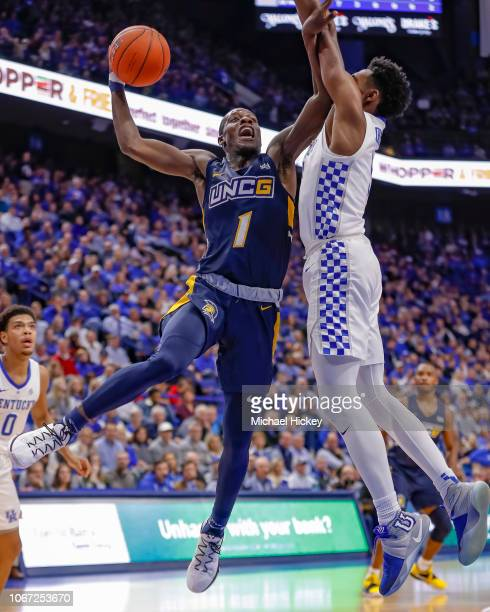 Isaiah Miller of the UNC-Greensboro Spartans shoots the ball against Immanuel Quickley of the Kentucky Wildcats at Rupp Arena on December 1, 2018 in...