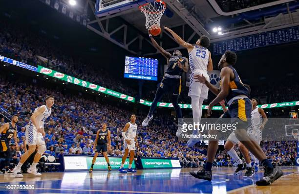 Isaiah Miller of the UNC-Greensboro Spartans shoots the ball against EJ Montgomery of the Kentucky Wildcats at Rupp Arena on December 1, 2018 in...