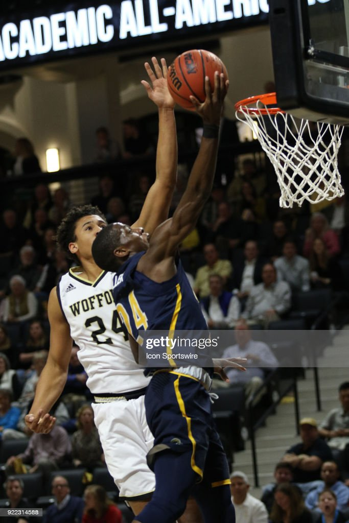 Isaiah Miller (24) UNC Greensboro gets past the defense to score two points during action against Wofford at Jerry Richard indoor stadium in Spartanburg,SC on Tuesday February 20, 2018.
