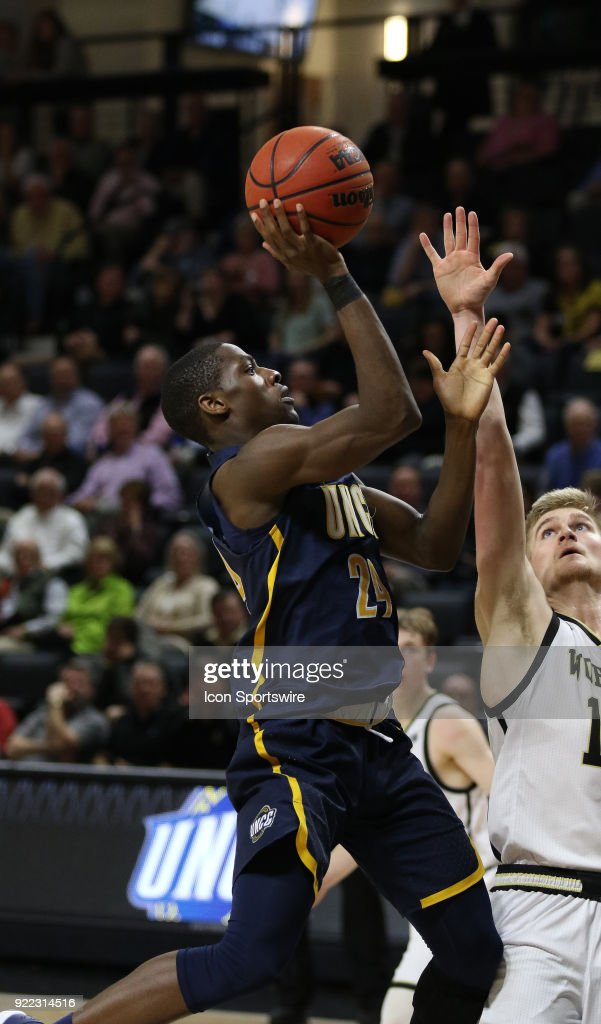 Isaiah Miller (24) UNC Greensboro puts up a shot during action against Wofford at Jerry Richard indoor stadium in Spartanburg,SC on Tuesday February 20, 2018.
