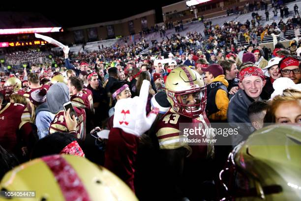 Isaiah Miranda of the Boston College Eagles celebrates with fans after they stormed the field at Alumni Stadium on October 26 2018 in Chestnut Hill...