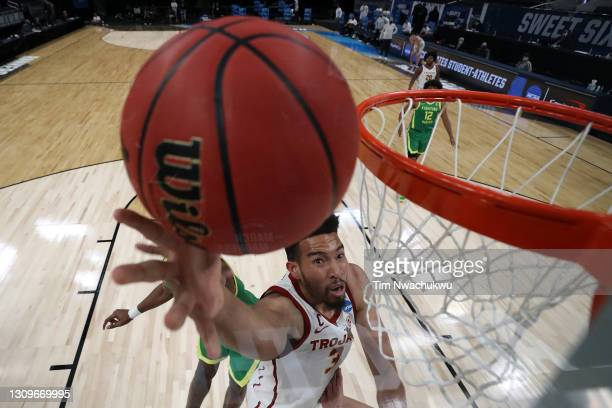 Isaiah Mobley of the USC Trojans goes up for a shot against the Oregon Ducks in the first half of their Sweet Sixteen round game of the 2021 NCAA...