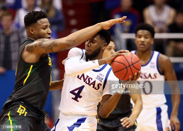 Isaiah Moss of the Kansas Jayhawks controls the ball as Mark Vital of the Baylor Bears defends during the game at Allen Fieldhouse on January 11,...
