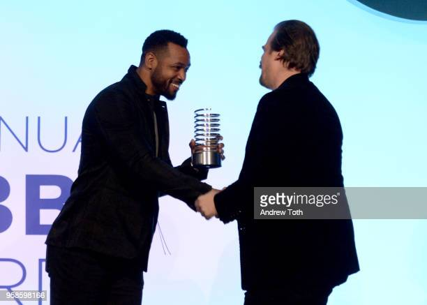 Isaiah Mustafa presents Actor David Harbour with award onstage at The 22nd Annual Webby Awards at Cipriani Wall Street on May 14 2018 in New York City