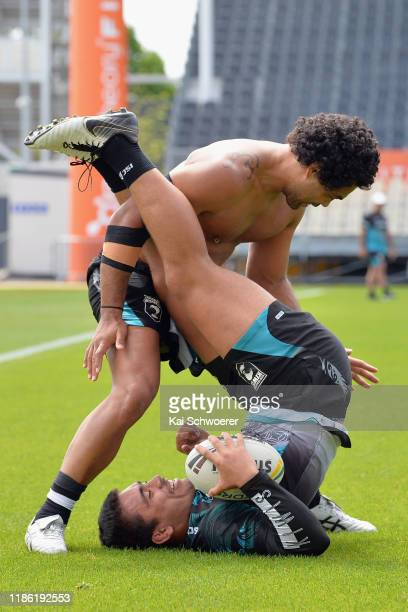 Isaiah Papalii is tackled by Adam Blair during a New Zealand Kiwis Rugby League training session at Orangetheory Stadium on November 08, 2019 in...