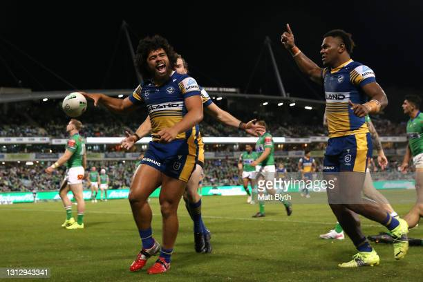 Isaiah Papali'i of the Eels celebrates with team mates after scoring a try during the round six NRL match between the Canberra Raiders and the...