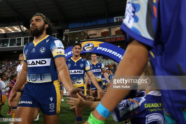 Isaiah Papali'i of the Eels high fives the members of the guard of honour as both team walk out during the round seven NRL match between the...