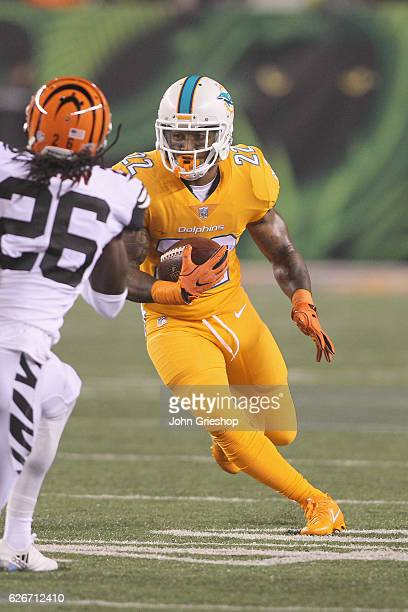 Isaiah Pead of the Miami Dolphins runs the football upfield during the game against the Cincinnati Bengals at Paul Brown Stadium on September 29 2016...