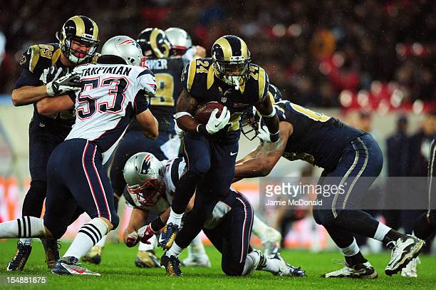 Isaiah Pead of the St Louis Rams breaks away during the NFL International Series match between the New England Patriots and the St Louis Rams at...