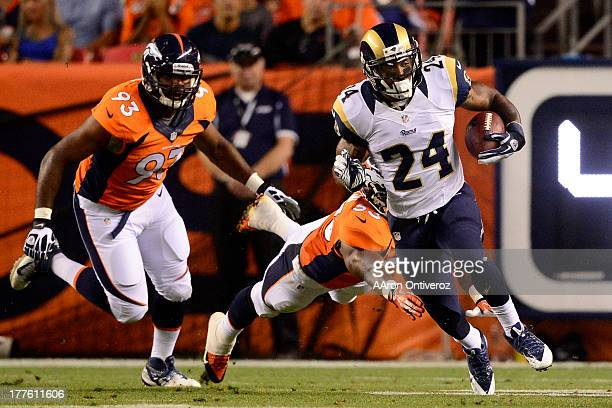 Isaiah Pead of the St Louis Rams breaks into the open field on a run against the Denver Broncos during the second half of action of an NFL preseason...