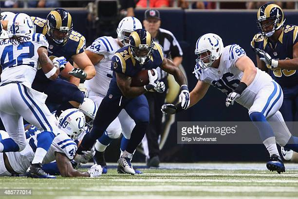 Isaiah Pead of the St Louis Rams carries the ball against Hugh Thornton of the Indianapolis Colts in the third quarter during a preseason game at the...