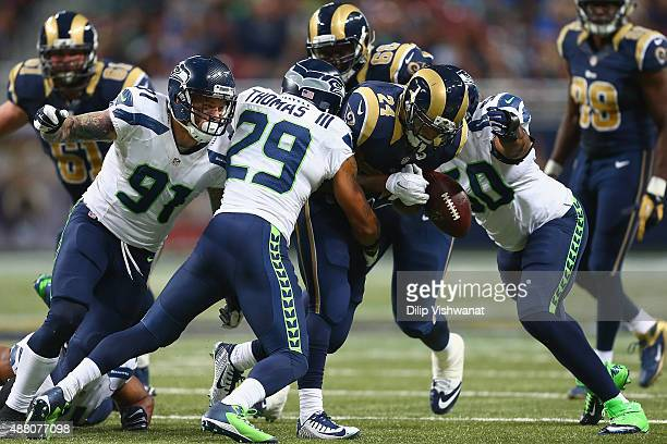 Isaiah Pead of the St Louis Rams fumbles the ball in the fourth quarter against the Seattle Seahawks at the Edward Jones Dome on September 13 2015 in...