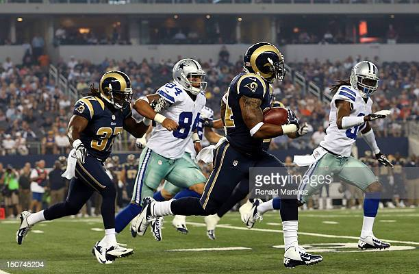Isaiah Pead of the St Louis Rams returns the ball against the Dallas Cowboys at Cowboys Stadium on August 25 2012 in Arlington Texas