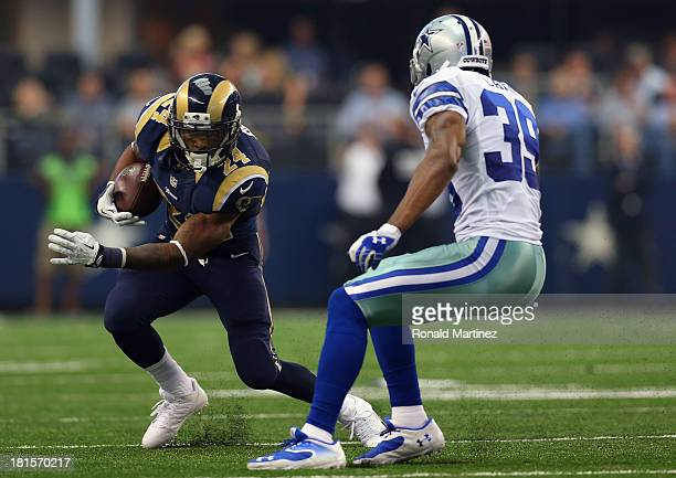 Isaiah Pead of the St Louis Rams runs the ball against Brandon Carr of the Dallas Cowboys at ATT Stadium on September 22 2013 in Arlington Texas