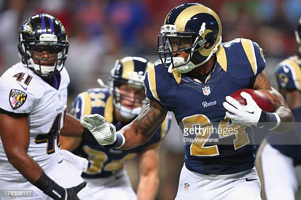 Isaiah Pead of the St Louis Rams rushes against the Baltimore Ravens during a preseason game at the Edward Jones Dome on August 29 2013 in St Louis...