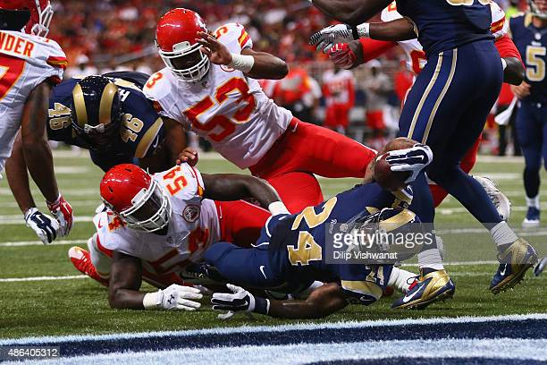 Isaiah Pead of the St Louis Rams scores a touchdown against the Kansas City Chiefs in the first quarter during a preseason game at the Edward Jones...