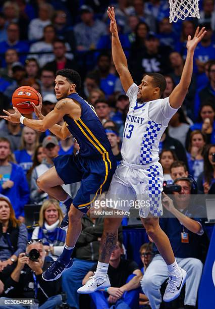 Isaiah Reese of the Canisius Golden Griffins passes the ball off as Isaiah Briscoe of the Kentucky Wildcats at Rupp Arena Stadium on November 13 2016...