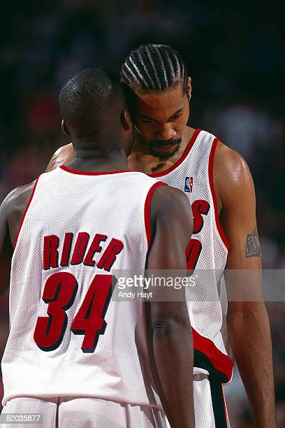 Isaiah Rider and Rasheed Wallace of the Portland Trailblazers talk things over during the NBA game against the Utah Jazz on May 22 1999 NOTE TO USER...