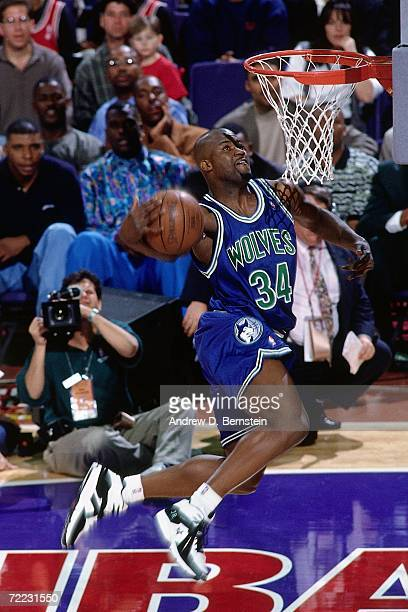 Isaiah Rider of the Minnesota Timberwolves attempts a dunk during the 1995 Slam Dunk Contest on February 11 1995 at the America West Arena in Phoenix...