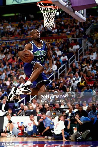 Isaiah Rider of the Minnesota Timberwolves goes up for a slam dunk during the Slam Dunk Contest prior to the 1995 NBA AllStar game on February 11...