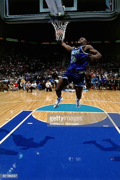 Isaiah Rider of the Minnesota Timberwolves goes up for a slam dunk during the NBA Slam Dunk Contest prior to the 1994 NBA All-Star game on February...