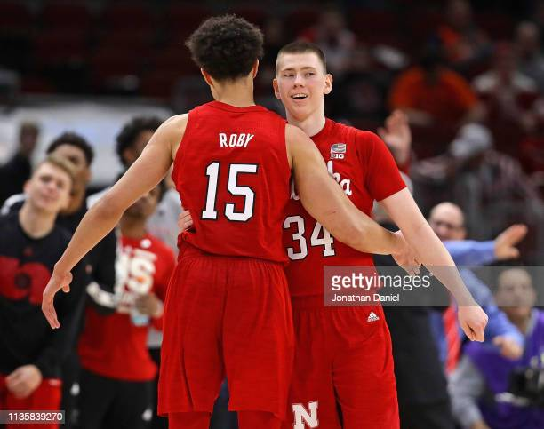 Isaiah Roby and Thorir Thorbjarnarson of the Nebraska Cornhuskers celebrate a win over the Maryland Terrapins at the United Center on March 14 2019...