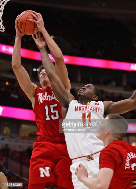Isaiah Roby of the Nebraska Cornhuskers rebounds over Darryl Morsell of the Maryland Terrapins at the United Center on March 14 2019 in Chicago...