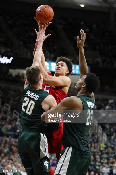 Isaiah Roby of the Nebraska Cornhuskers takes a second half shot over Matt McQuaid of the Michigan State Spartans at Breslin Center on March 05 2019...