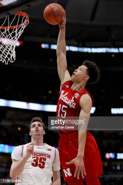 Isaiah Roby of the Nebraska Huskers dunks the ball past Nate Reuvers of the Wisconsin Badgers in the first half during the quarterfinals of the Big...
