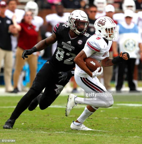 Isaiah Rodgers of the Massachusetts Minutemen returns the ball after he intercepted a pass intended for Jesse Jackson of the Mississippi State...