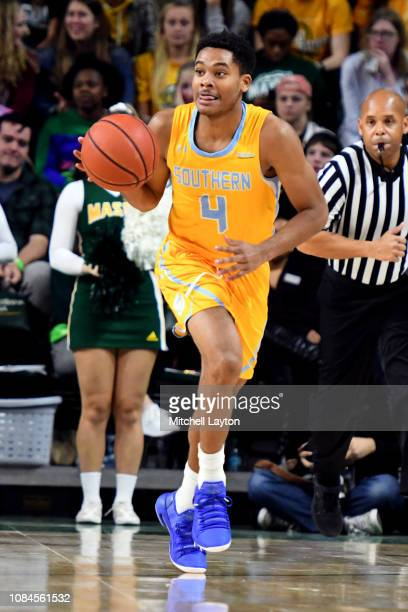 Isaiah Rollins of the Southern University Jaguars dribbles up court during a college basketball game against the George Mason Patriots at the Eagle...