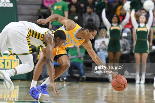 Isaiah Rollins of the Southern University Jaguars goes a after a loose ball during a college basketball game against the George Mason Patriots at the...