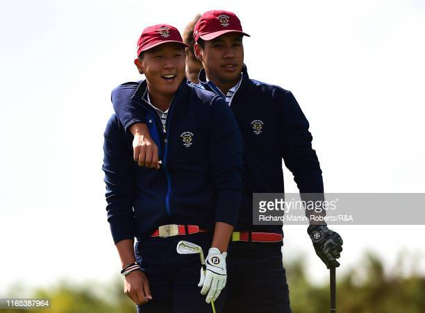 Isaiah Salinda and John Pak of the United States react on the 4th hole during a practice round at Royal Birkdale Golf Club prior to the 2019 Walker...