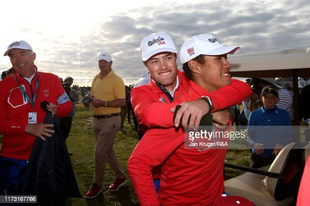 Isaiah Salinda of the United States carries teammate Cole Hammer as they celebrate victory following the singles matches during Day 2 of the Walker...