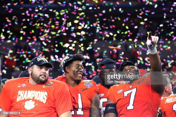 Isaiah Simmons and Austin Bryant of the Clemson Tigers celebrate after defeating the Notre Dame Fighting Irish during the College Football Playoff...