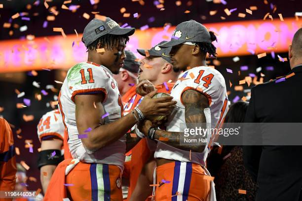 Isaiah Simmons and Diondre Overton of the Clemson Tigers celebrate their teams 2923 win over the Ohio State Buckeyes in the College Football Playoff...
