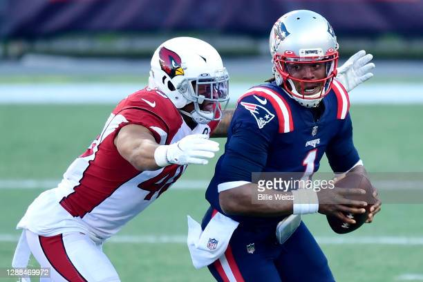 Isaiah Simmons of the Arizona Cardinals sacks Cam Newton of the New England Patriots during the second quarter of the game at Gillette Stadium on...