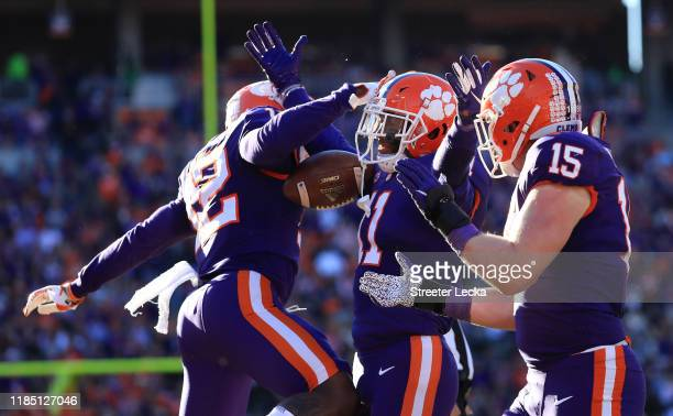 Isaiah Simmons of the Clemson Tigers celebrates with teammates after an interception against the Wofford Terriers during their game at Memorial...