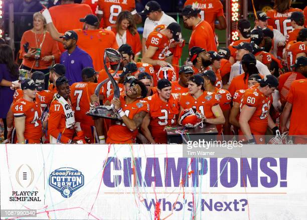 Isaiah Simmons of the Clemson Tigers celebrates with the trophy after defeating the Notre Dame Fighting Irish during the College Football Playoff...
