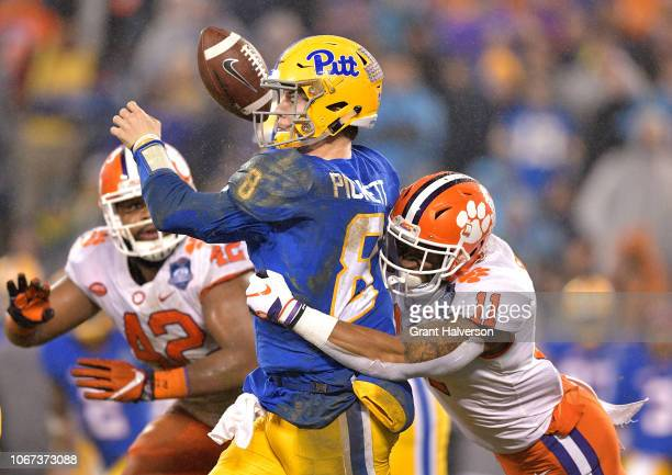 Isaiah Simmons of the Clemson Tigers forces a fumble by Kenny Pickett of the Pittsburgh Panthers during their game at Bank of America Stadium on...
