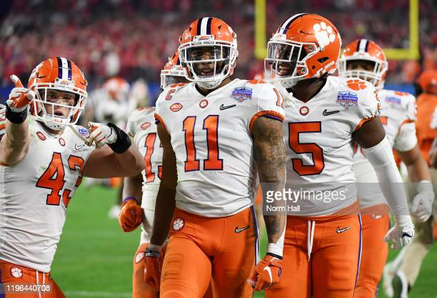 Isaiah Simmons of the Clemson Tigers is congratulated by his teammates after an interception against the Ohio State Buckeyes in the second half...