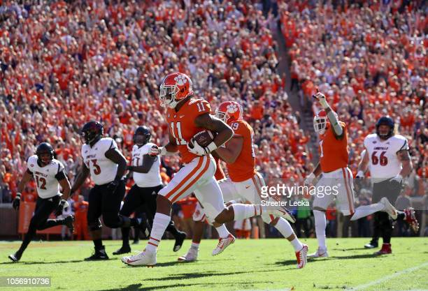Isaiah Simmons of the Clemson Tigers returns an interception for a touchdown against the Louisville Cardinals during their game at Clemson Memorial...
