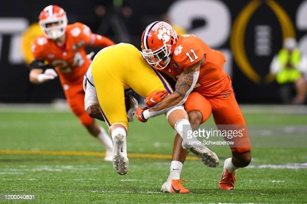 Isaiah Simmons of the Clemson Tigers tackles Thaddeus Moss of the LSU Tigers during the College Football Playoff National Championship held at the...