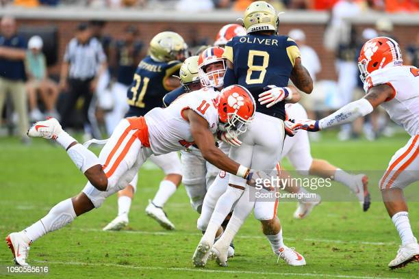Isaiah Simmons of the Clemson Tigers tackles Tobias Oliver of the Georgia Tech Yellow Jackets on September 22 2018 in Atlanta Georgia