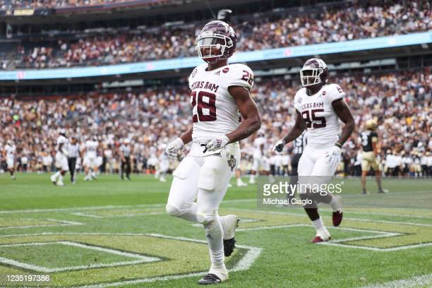 Isaiah Spiller of the Texas A&M Aggies celebrates after catching a touchdown pass against the Colorado Buffaloes during the fourth quarter at Empower...