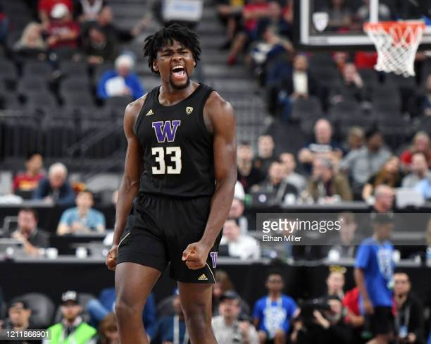 Isaiah Stewart of the Washington Huskies reacts after scoring against the Arizona Wildcats during the first round of the Pac-12 Conference basketball...